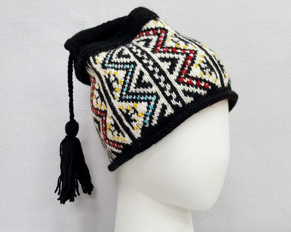 black knit beanie with tassel