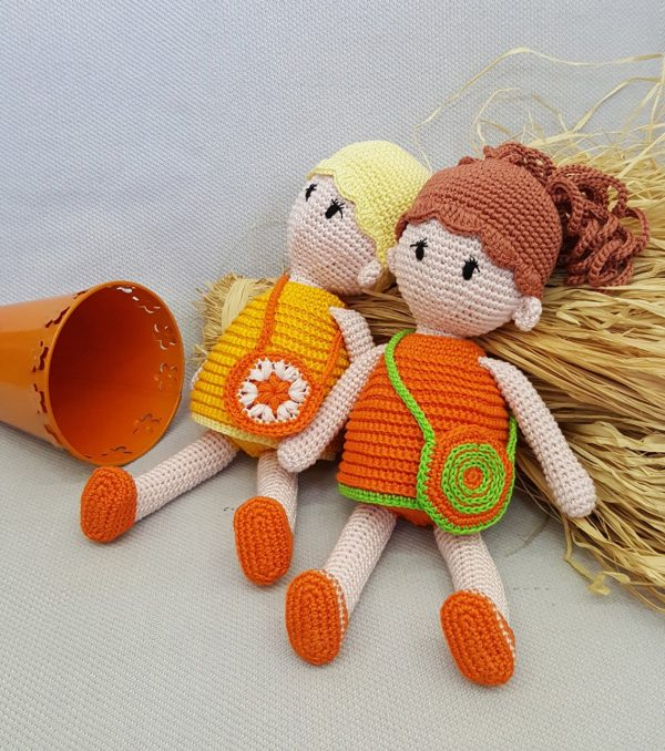 yellow and orange dolls