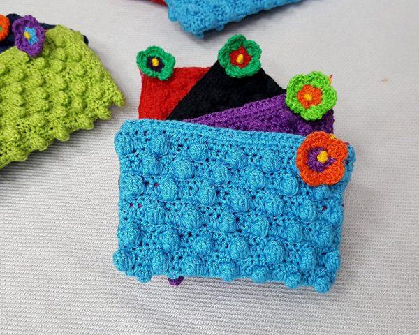 blue crochet toiletry bag
